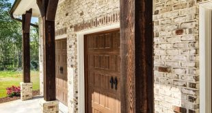 Get the look: Pine Hall Oyster Pearl Brick with deep brown stained timbers and d...