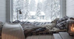Ein warmes Bett mit herrlicher Aussicht in einem abgelegenen, schneebedeckten Häuschen.