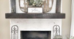 Painted white brick fireplace. Tobacco basket over fireplace. Farmhouse style li...