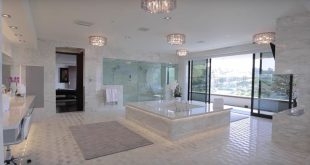 This newly built modern mega mansion is located at 10979 Chalon Road in the Bel ...